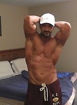 Muscular guy plays with his cock & cums